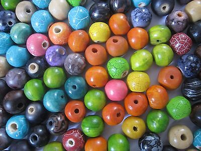 Loose beads. Multi-coloured wooden beads approximately 14mm - 18mm.