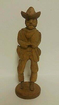 Folk Art Hand Carved Wood Cowboy On A Stand