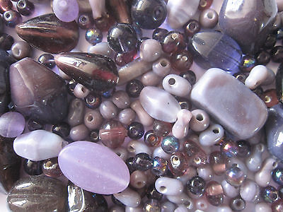 Loose beads. 50 Vintage glass beads in shades of purple.