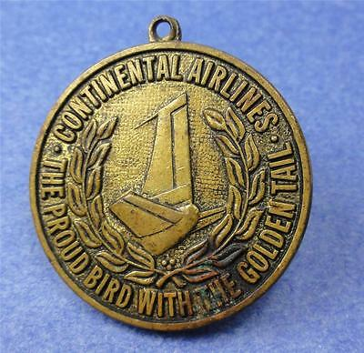 """CONTINENTAL AIRLINES Fob/Medal """"Proud Bird with the Golden Tail"""" 28mm ME1069"""