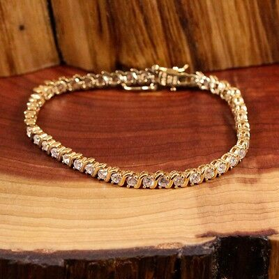 LADIES BEAUTIFUL 18ct GOLD OVER .925 SILVER AND CZS  7 INCH TENNIS BRACELET.