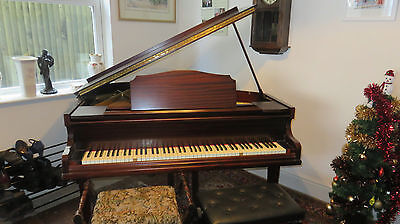 A Monington and Weston Baby grand piano
