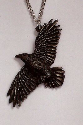 Raven on the Wind Pendent.....  Origainl Hand Carved