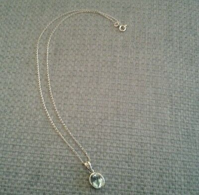Silver necklace with blue topaz stone