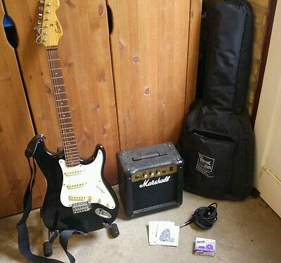 Encore electric guitar, Marshall amp, lead and carry bag