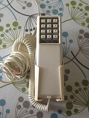 Vintage wall mounted slimline push button telephone