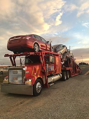 2000 Freightliner Truck with 8-9 Cottrell car hauling trailer