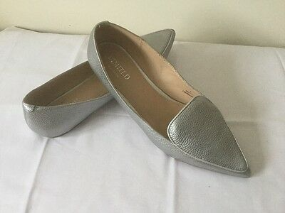 Ladies leather flat shoes size 7. Silver leather M & S shoes size 7