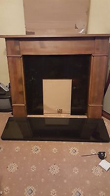 black marble fireplace wooden surround and electric fire