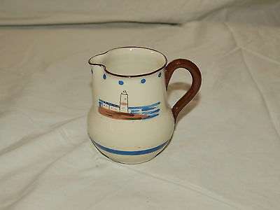 "TORQUAY POTTERY 'PORTLAND BILL' LIGHTHOUSE JUG  3.75"" high- illegible round mark"