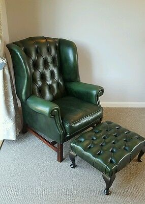 Leather antique Chesterfield wing back armchair with matching footstool