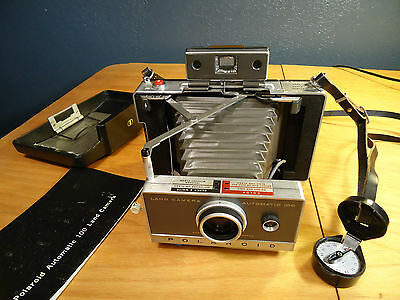 VINTAGE Polaroid Land Camera Automatic 100 with book, case , timer, cold clip