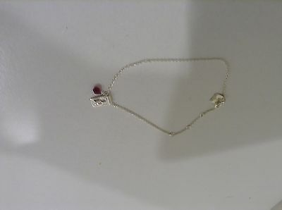 Silver bracelet by charlotte with ruby stone
