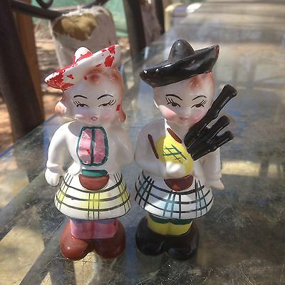 Two Scottish Male Holding Bagpipes And Female Salt And Pepper Shakers