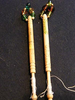 Pair of spangled wooden lace bobbins Easter 1993, Fernlace craft day 2006