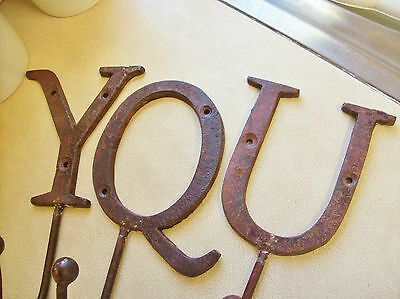 Three unusual solid cast iron letter's Y Q U  with added coat / kitchen hook's