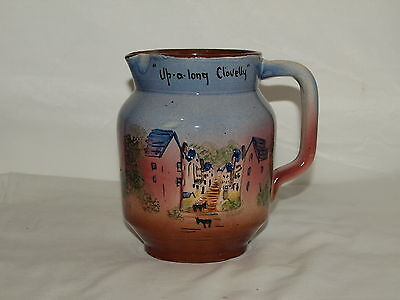 TORQUAY POTTERY COMPANY HELE CROSS RELIEF MOULDED JUG 'Up-a-long-Clovelly'