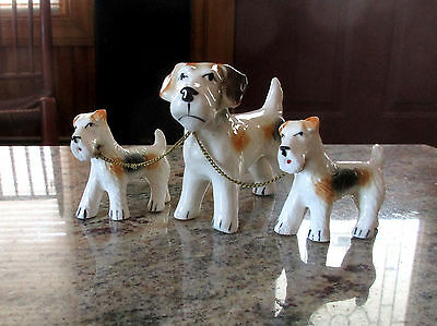 Vintage Porcelain Figurines of a Fox Terrier Dog With Two Puppies on Chains