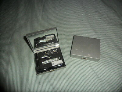 Shaving travel kits x 2 with toothbrush, little mirror and metal box. Unused