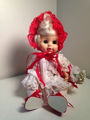 HORSMAN Collectible Doll With Red And White Hood And Flowers Collectible B1769