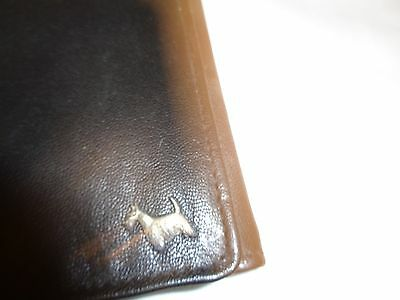 vintage leather (?) credit card case with metal scottie scotty dog in corner