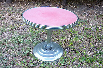 Retro 1950's side table with metal edging .
