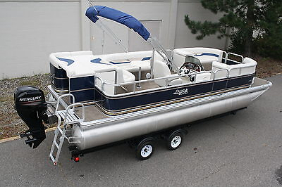 New 22 ft pontoon boat with 50 four stroke and trailer