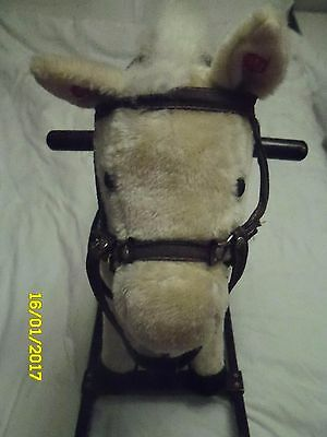 Rocking horse With Push Buttons On Each Ear One Makes Trotting Noise the Others
