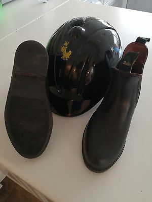 girls horse riding boots and helmet