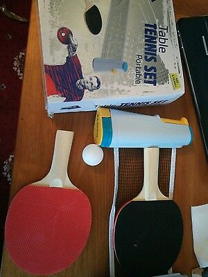 portable table tennis net with bats and ball