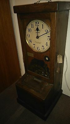 A vintage industrial time recorder clock