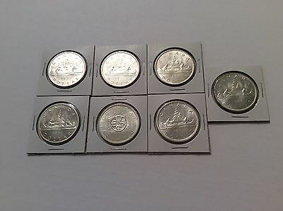Lot Of 7 Uncirculated Canadian Silver Dollars