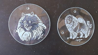 Keeshond- Two beautifully hand engraved glass coasters by Ingrid Jonsson