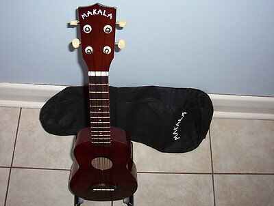 ukulele soprano MAKALA dolphin series-  Brown with bag and stand