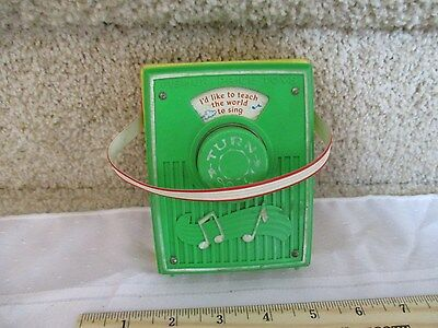 Vintage Fisher Price Pocket Radio Music Box works Like to teach the world Sing