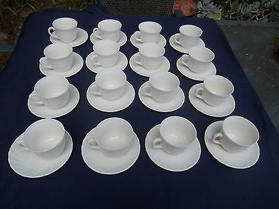 Aset Of Arcopal Cups And Saucers.