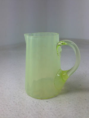 Old antique Victorian small vaseline glass jug