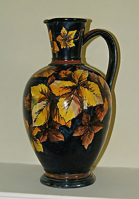 A Doulton Faience stoneware jug, dated 1881, decorated by Florence M. Linnell