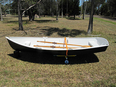 Wooden sailing rowing dinghy