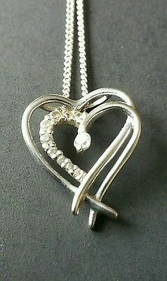 9ct White gold and cubic zirconia  heart pendant. H Samuels.