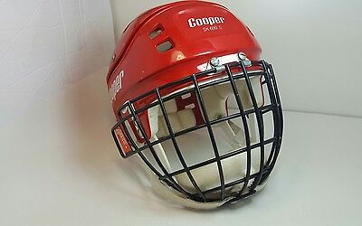 COOPER SK 600s RED HOCKEY HELMET with HM50s goalie black cage in good condition.