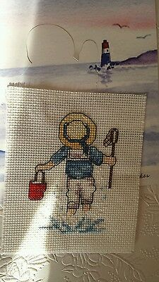 Completed cross stitch boy at the seaside
