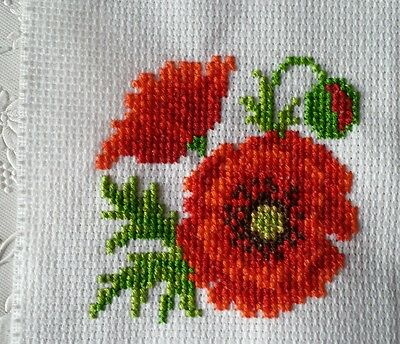 Completed cross stitch poppies
