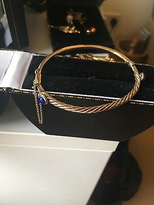 Classic elegant 9ct gold Art Deco bangle with lapis lazuli