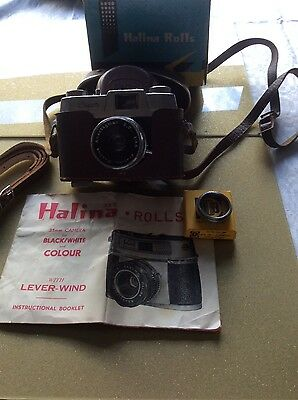 2  Cameras Canon 35 mm and Halina Rolls 35 mm