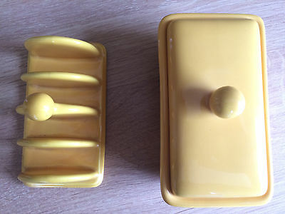 Pottery orange toast rack and matching butter dish