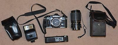 Canon AE-1 Program With 50 mm & 35 - 135 mm Lens, Flash & Power Winder