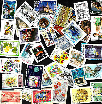 100 Large/Commemorative world stamps from Kiloware on paper. Ref W 2017/04.