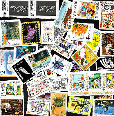 100 Large/Commemorative world stamps from Kiloware on paper. Ref W 2017/07.