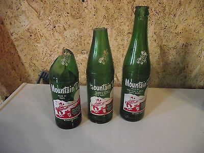 3 different Mountain Dew hillbilly bottles: Toots, Mabel and an 8 namer